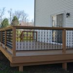 Twistered & Black Metals Railings With Wooden Frames Grey Exterior With Siding Walls And Sliding Glass Door