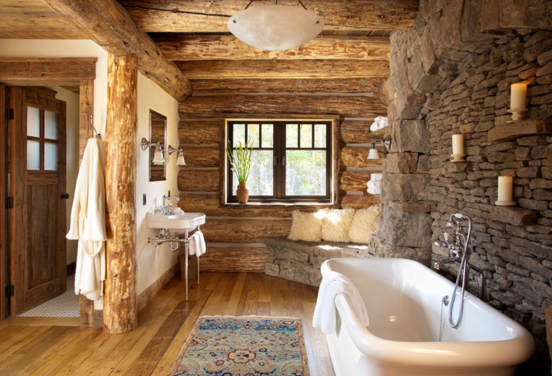two floor stone and log house carpet bathtub stone wall logs window glass mirror bench door wood floor