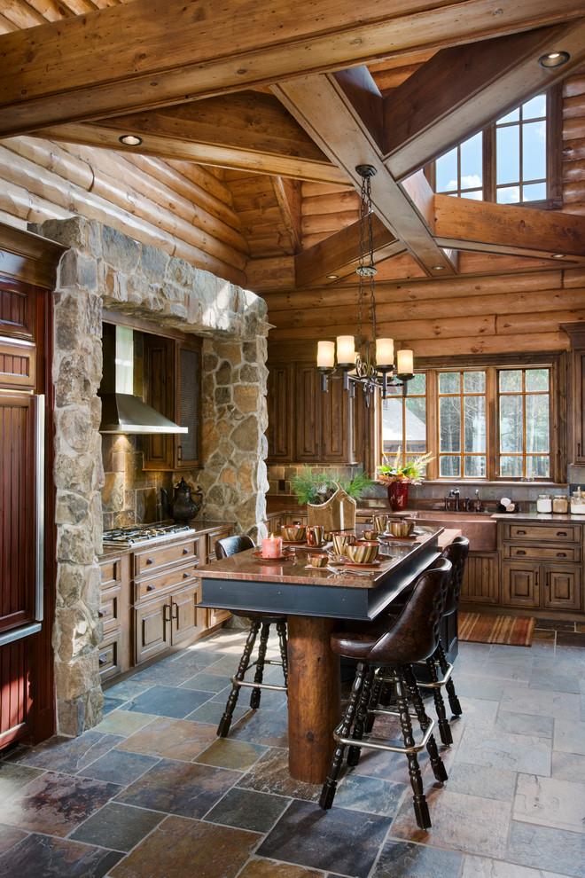 two floor stone and log house kitchen dining chairs table windows cabinets floor tile lighting hanging lights
