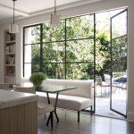 Unique Steel Doors Wood Floor Hanging Lamps Bookshelves Chairs Table Steel Door Outside Area Glass