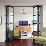 unique steel doors wood floor seating carpet table sofa lamp flowers hanging lamps painting folring door glass