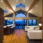 Vaulted Living Room Open To Kitchen With White Ceiling, Pendant Lamps, Lamps On The Ceiling, White Sofa, White Counter Top Kitchen