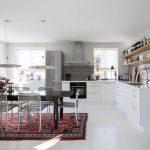 White Cabinet Brick Grey Backsplash Floating Wooden Shelves Modern Pendat Lights Tribal Rug Wire Stools