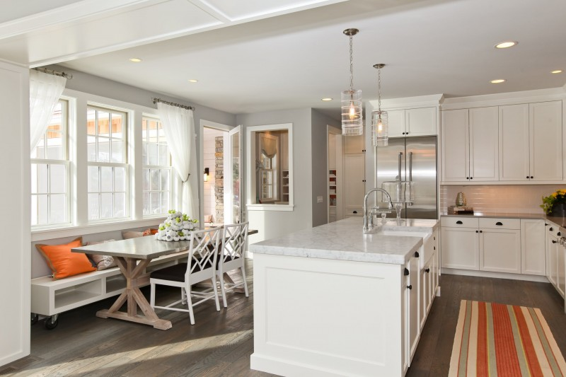 white cabinet granite countertop pendant lights stripped rug contemporary shelved seat dark hardwood floor