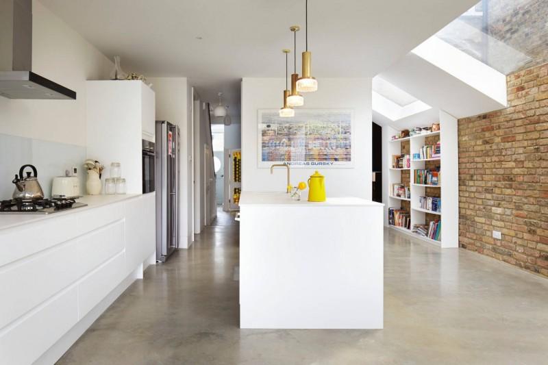 white flat panel cabinet white pendant lights brick wall glass ceiling white book shelves