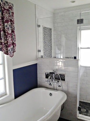 white small master bathroom with white bathtube, and separated toilet area