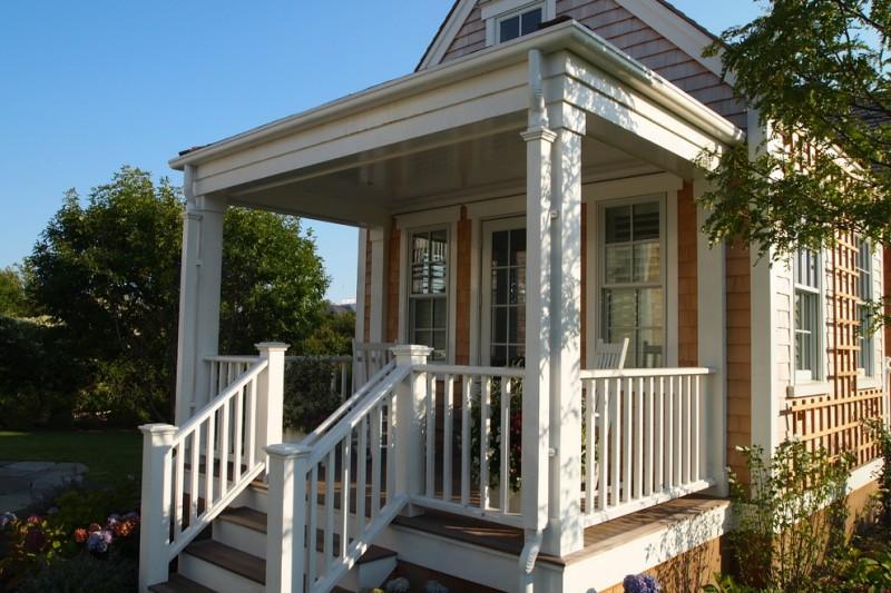 white wooden vertical railing