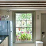 window outside finishing designs low window cabinet ceiling lamp wood floor tile trash bin door lighting