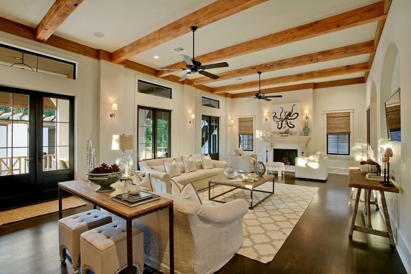 wood beams ceiling fans white sofa sofa table square coffee table dark hardwood floor