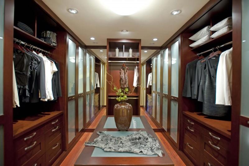 wooden high ceiling closet sliding door glass floor dark wooden floor open shelving cabinet marble vase