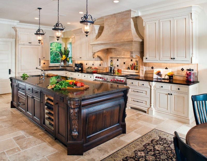 Victorian kitchen with dark wooden island, white wooden cabinet with black marble counter top, wall mounted cabinet, cooktop, brown marble chimney, black rustic pendants, brown tile flooring