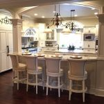 Victorian Kitchen With White Island White Marble Top, White Cabinet White Marble Top, White Wall Mounted Cabinet, White Cipboard, White Victorian Chandelier, Silver Stove Oven