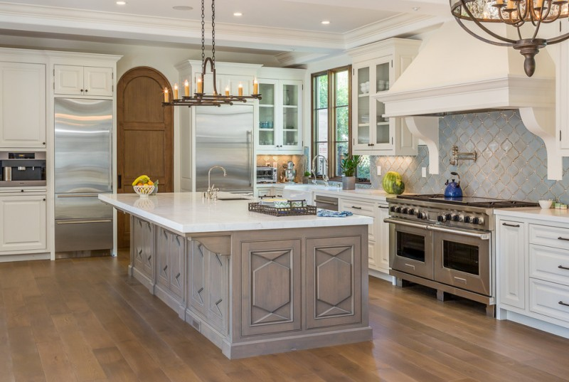 arabesque backsplash kitchen chandelier wood floor window mediterranean room wall cabinets window ceiling lights