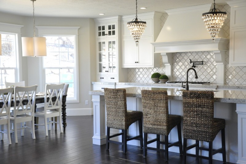arabesque backsplash kitchen dark floor dining chairs table hanging lights windows traditional room wall cabinets