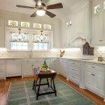 Arabesque Backsplash Kitchen Hardwood Floor Carpet Window Plates Ceiling Fan Wall Cabinets Traditional Room Table