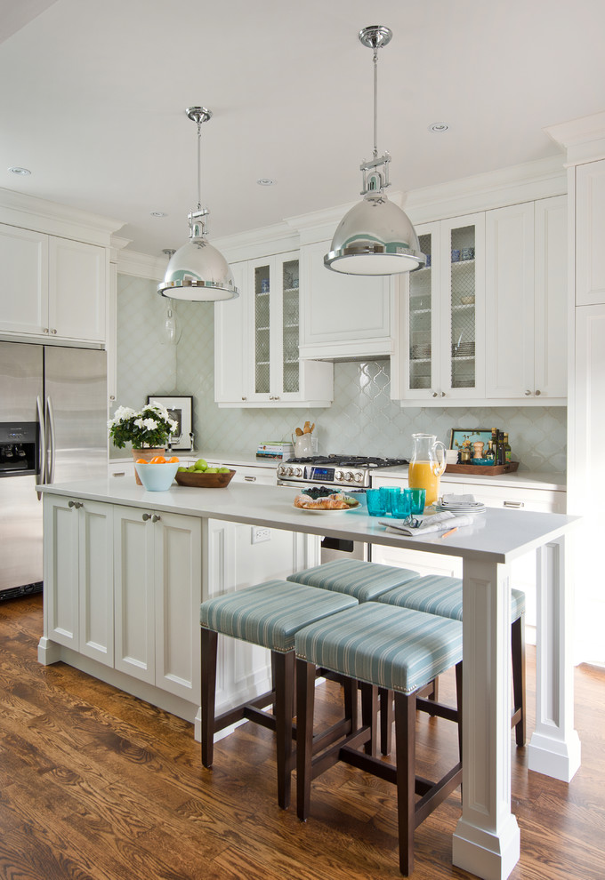 arabesque backsplash kitchen hardwood floor pendant lights stools wall cabinets flowers transitional room ceiling lamps