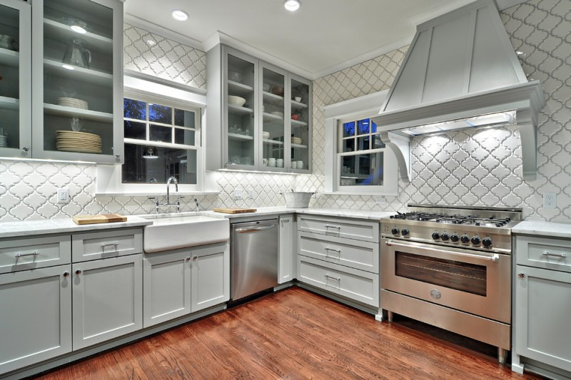 arabesque backsplash kitchen wall cabinets with glass doors windows faucet sink hardwood floor stove traditional room