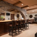 Bar Under The Bricks Archwall, With Wooden Bar With Yellow Marble Top, Wooden Stool With Leather Upholster