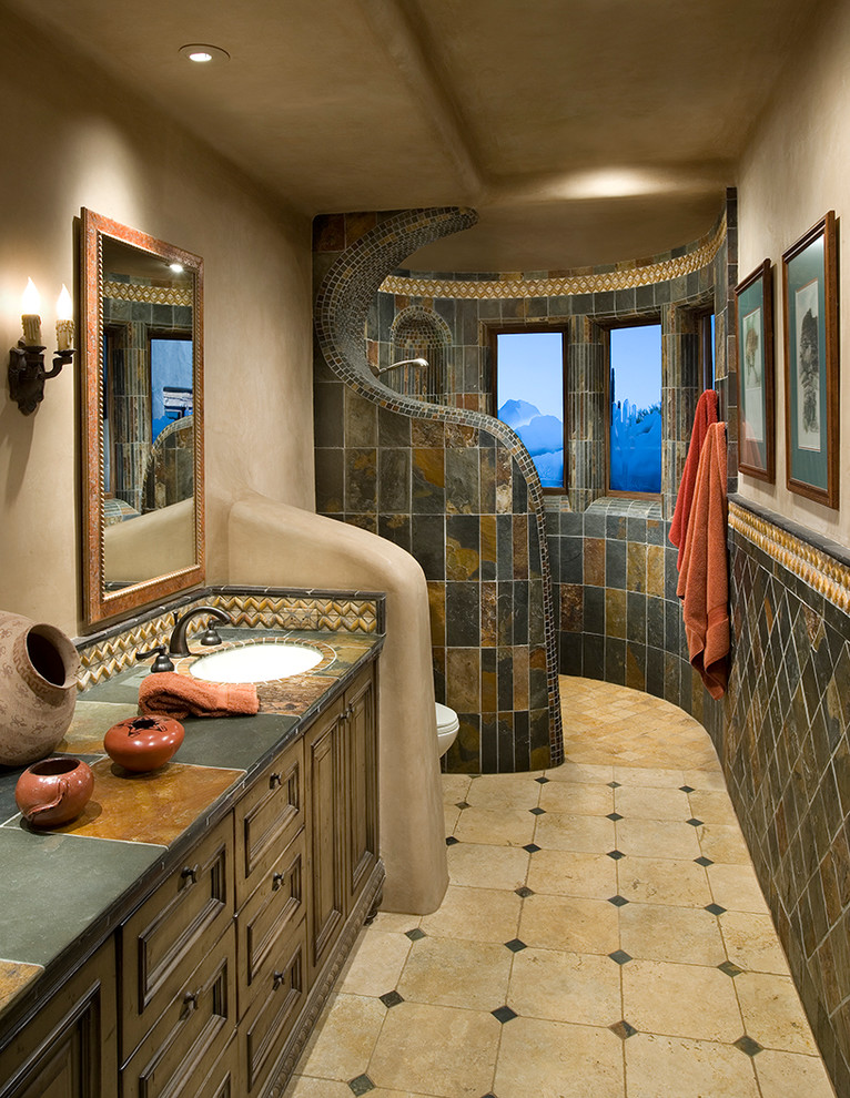 bathroom with brown tiles, different in shower area and sink area