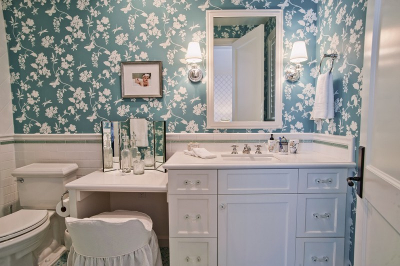 bathroom with flower wallpaper, white cabinet under white caesarstone countertop with sinks and makeup area, medium sized mirror, makeup mirror