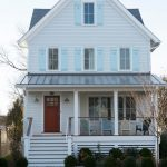 beach style exterior idea with white sidng walls mediterranean style windows with light blue panels colorful exterior chairs clean white house skirting in horizontal installations
