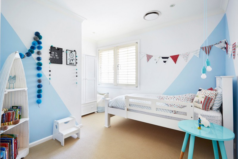 beach themed wall painting idea simple white bed frame blue bedside table boat shape book shelves in white