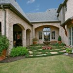 beautiful home gardens with fountains brick walls wall lamp plants grass fountain traditional landscape windows