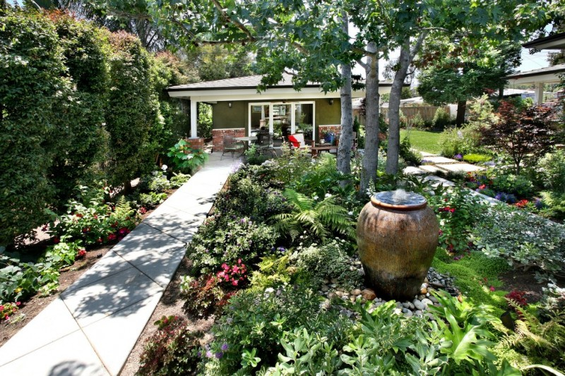 beautiful home gardens with fountains pathway flowers plants trees fountain in urn traditional landscape chairs table outdoor area