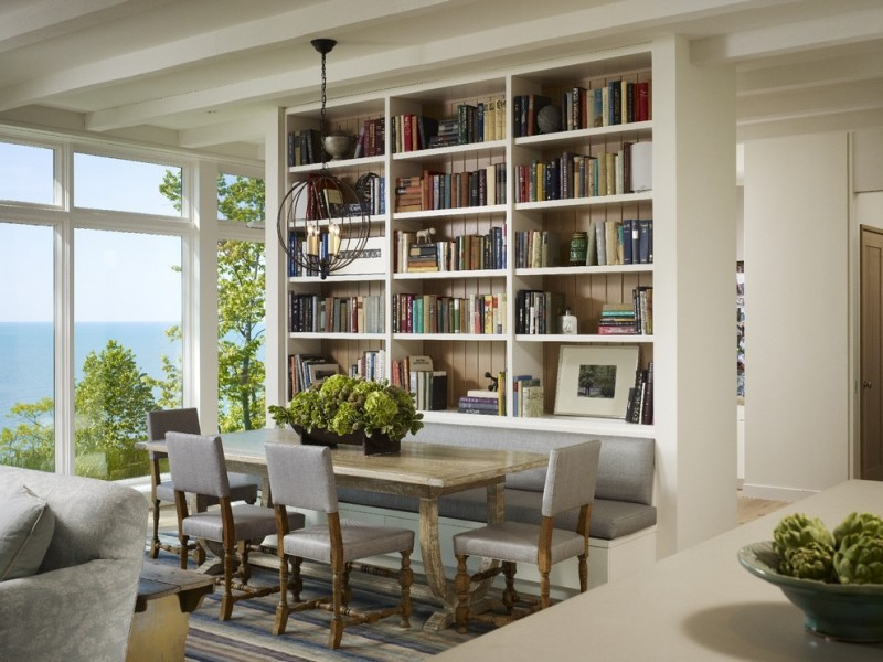 bench dining room table carpet big windows transitional style chairs chandelier bookshelves books