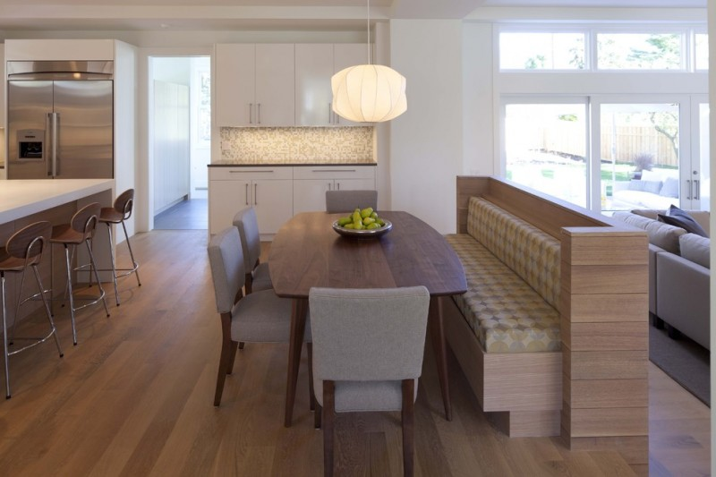 bench dining room table chairs door windows wood floor wall cabinets contemporary style hanging light
