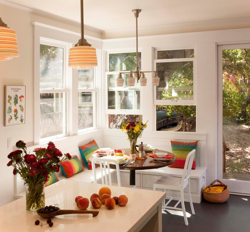 bench dining room table chairs pillows tables pendant lights chandelier windows traditional style flowers