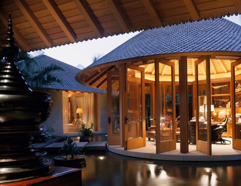big round gazebo with stone bridge, sliding glass doors, vaulted wooden ceiling, office room inside