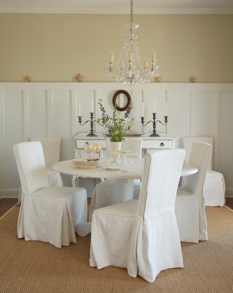 brass candle holder chandelier lamp white kitchen dining set white tapestry chairs round table rattan rug