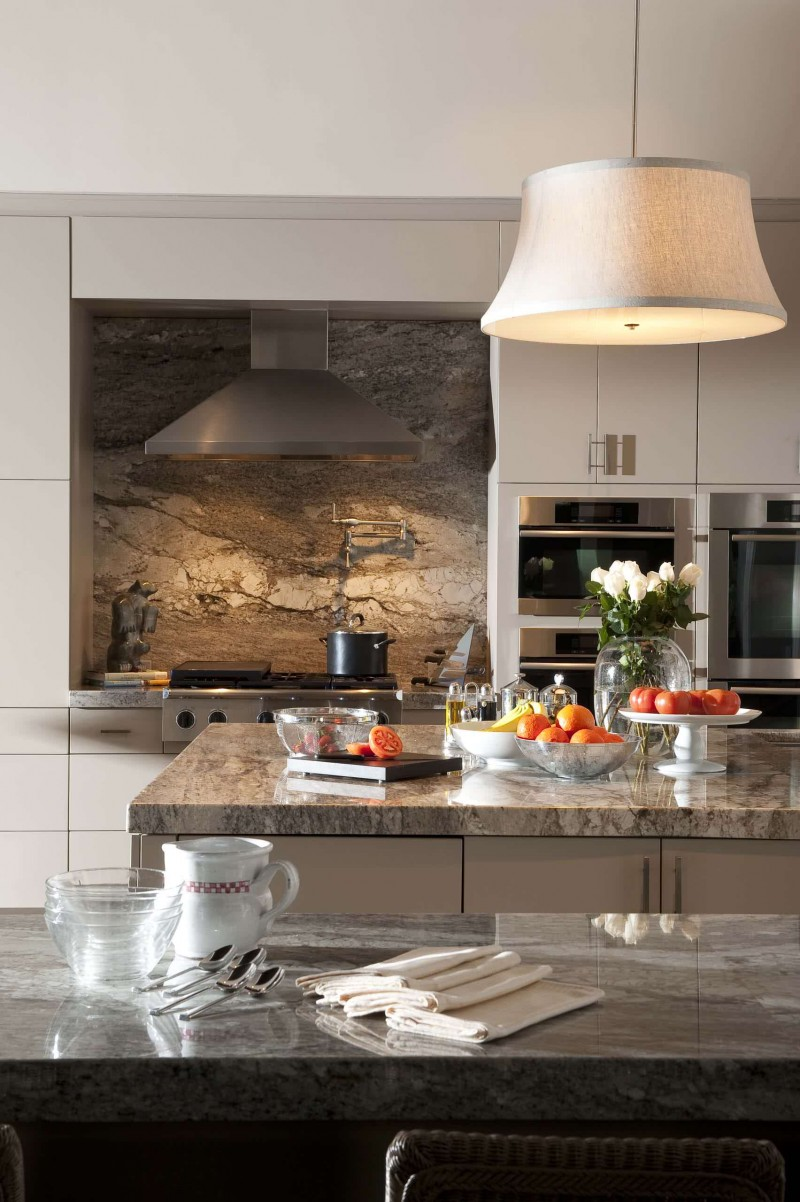 brown granite countertop brown granite backsplash metal hood white cabinet pendant light