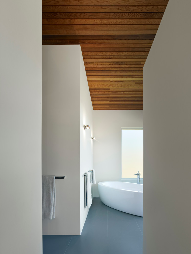 brown wooden ceiling planks in a bathroom with white walls