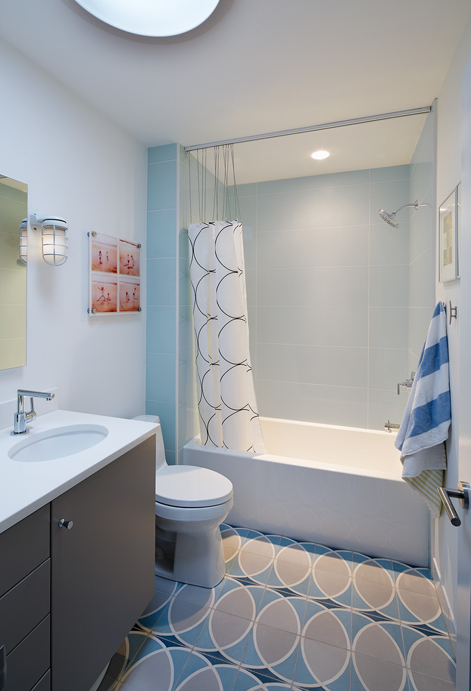 ceiling hung shower curtain cabinet mirror lamp interesting floor patterns bathtub midcentury bathroom towel rack