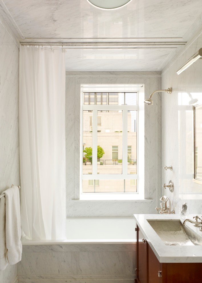 ceiling hung shower curtain window bathtub storage item towel rack traditional bathroom faucet