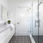 Cement Tile White Walls Engineered Quartz Countertops Flat Panel Cabinets White Cabinets An Undermount Sink Black And White Tile Rectangular Mirror