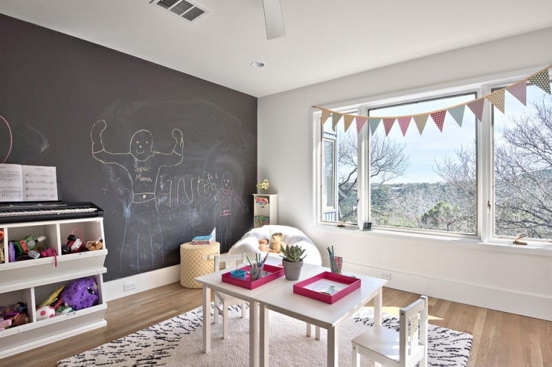 chalkboard and white walls idea white modern table and chairs for kids white bean bag chair white area rug with black accent white shelves medium toned wood floors yellow ottoman chair