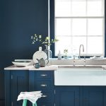 Classic White Porcelain Sink Navy Blue Cabinets White Countertop Light Blue Chair Navy Blue Wall Paint White Framed Windows