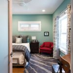 colour for walls in bedroom wood floor carpet table red chair windows curtains bed pillows ceiling fan lamp