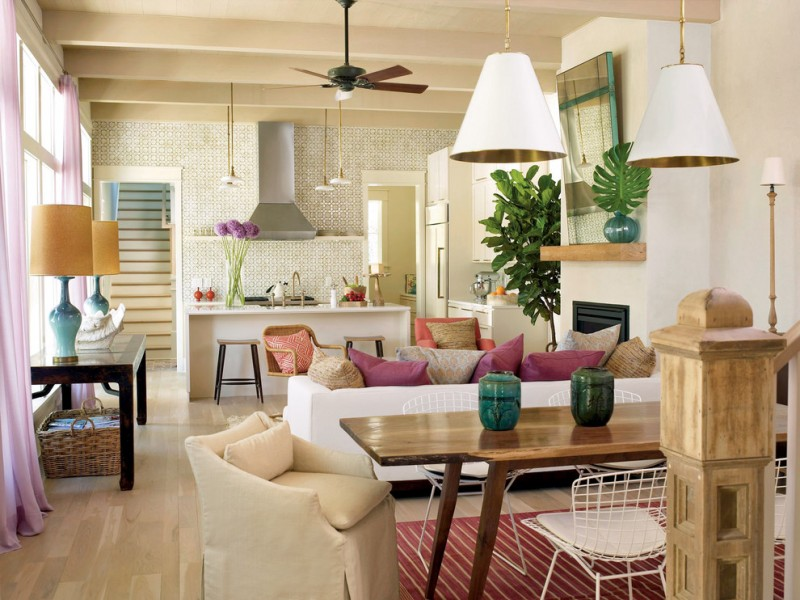 combination of dining, kitchen and living carpet sofa pillows pendant lights tables chairs ceiling fan basket tropical room