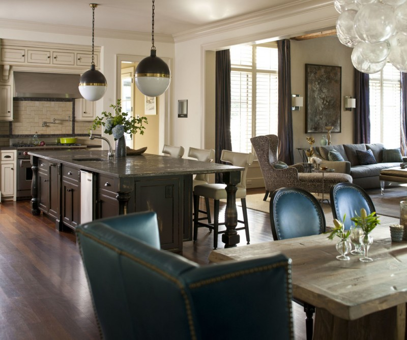 combination of dining, kitchen and living chairs pendant lights tables wood floor wall lamps curtains transitional style