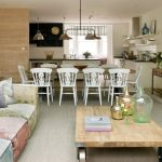 combination of dining, kitchen and living chairs table sofa pillows pendant lights shelves mirror decorative plants windows