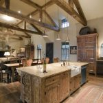 combination of dining, kitchen and living chairs wood floor cabinet pendant lights windows stove chairs tables rustic design