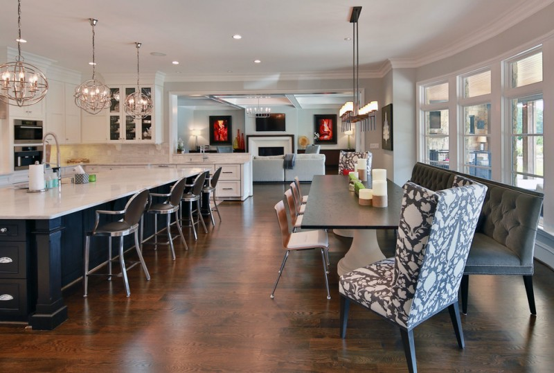 combination of dining, kitchen and living chandeliers chairs bench wood floor windows transitional style