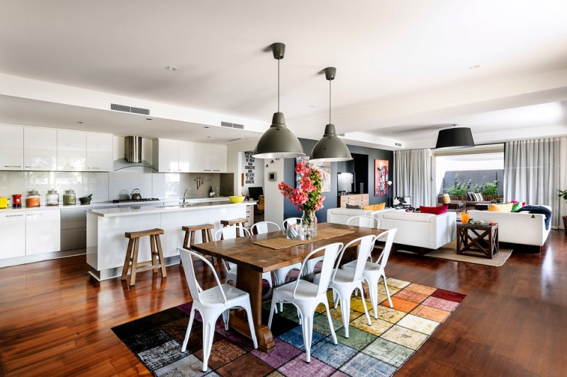 combination of dining, kitchen and living room carpet chairs wooden table floor pendant lights stools curtains painting contemporary style