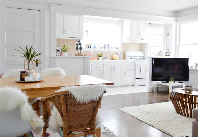 combination of dining, kitchen and living room carpet tv windows wall cabinet chairs table decorative plant eclectic room