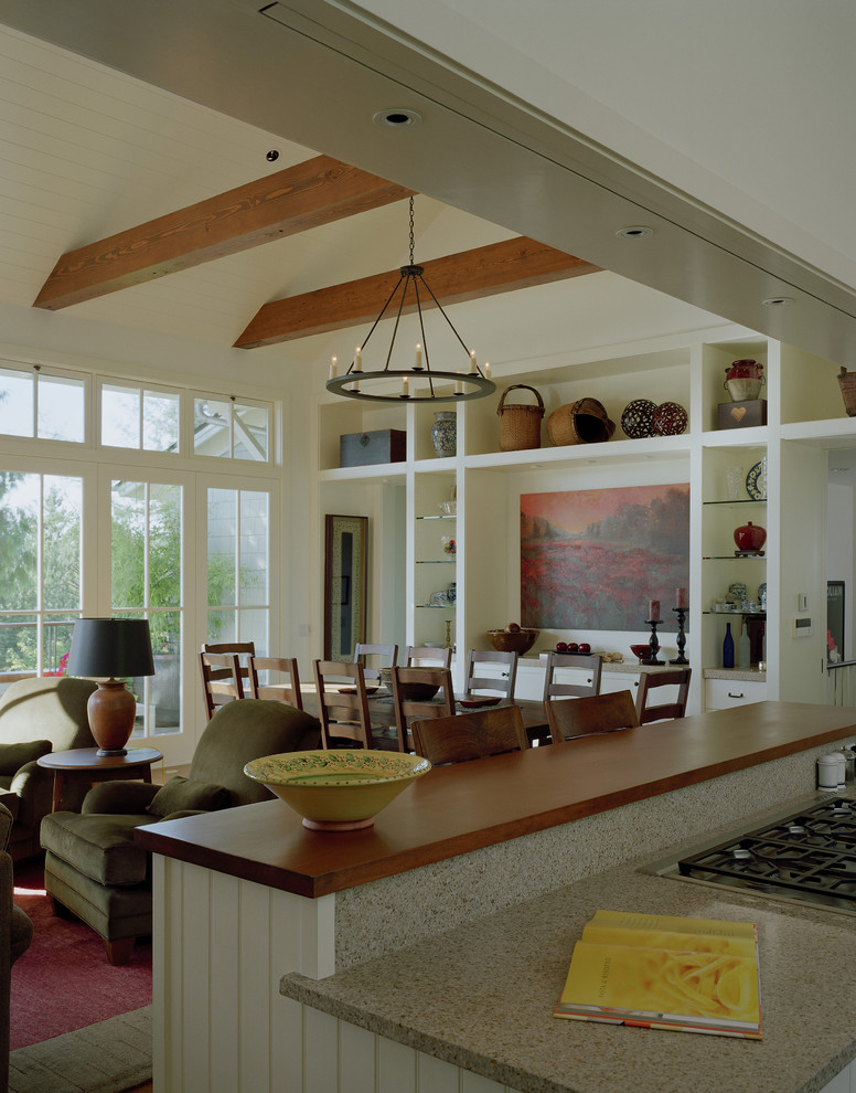 combination of dining, kitchen and living room chairs tables small table shelves chandelier window traditional style