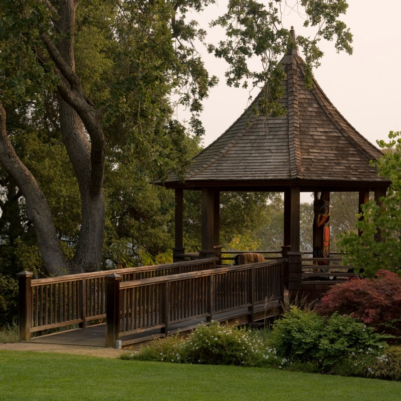 cone ceiling gazebo with wooden poles, wooden brigde